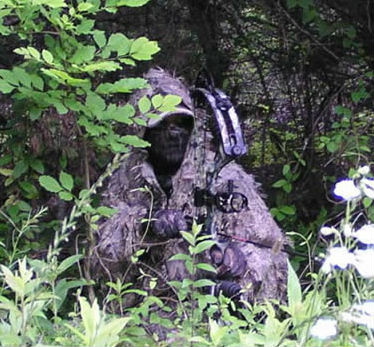 Camouflaged Coyote Bow Hunter